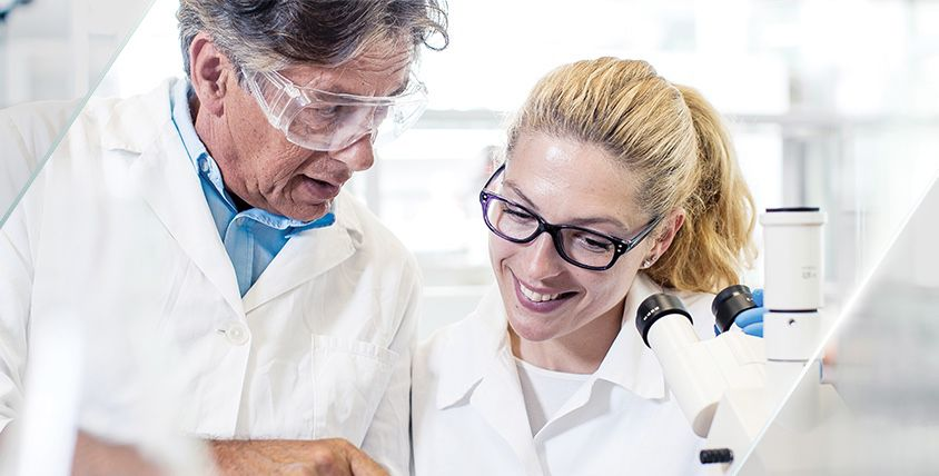 Two lab technicians working in a lab