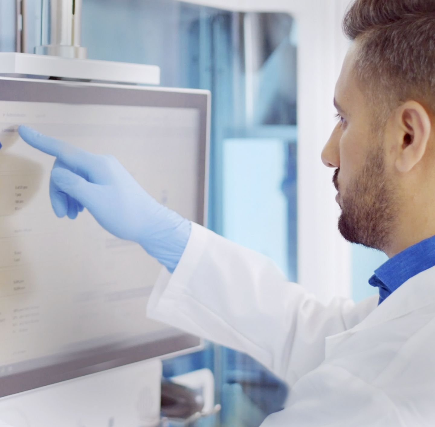 Lab technician touching monitor, integration image