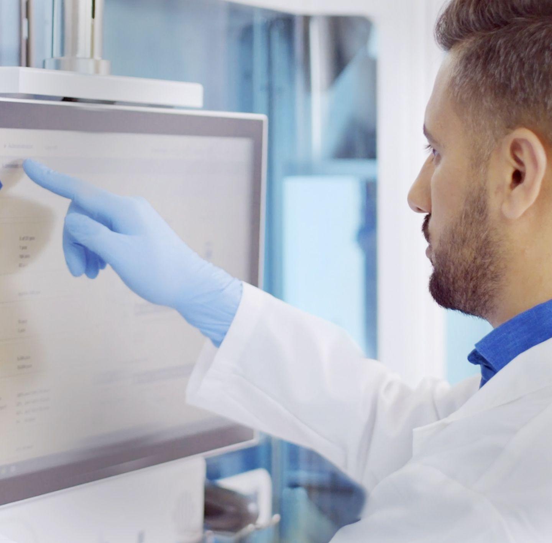 Lab technician touching monitor, integration image