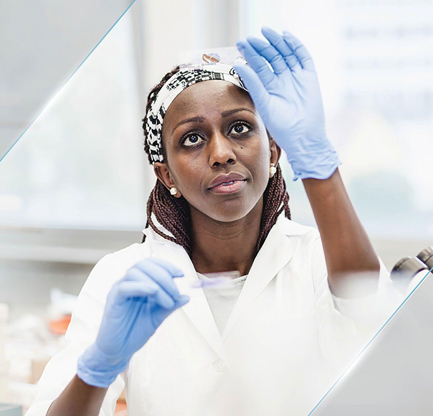 Anatomic pathology provider examining IHC slide