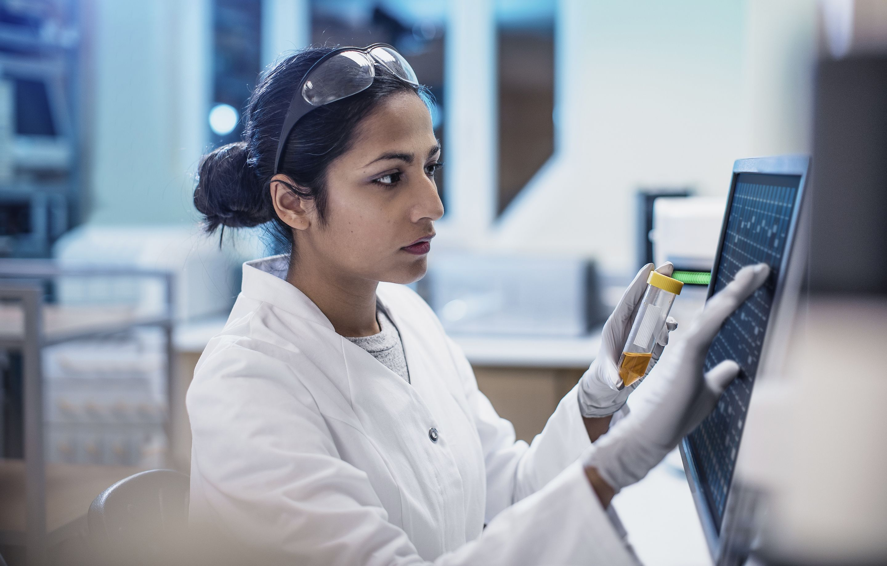 Female scientist using computer software in lab