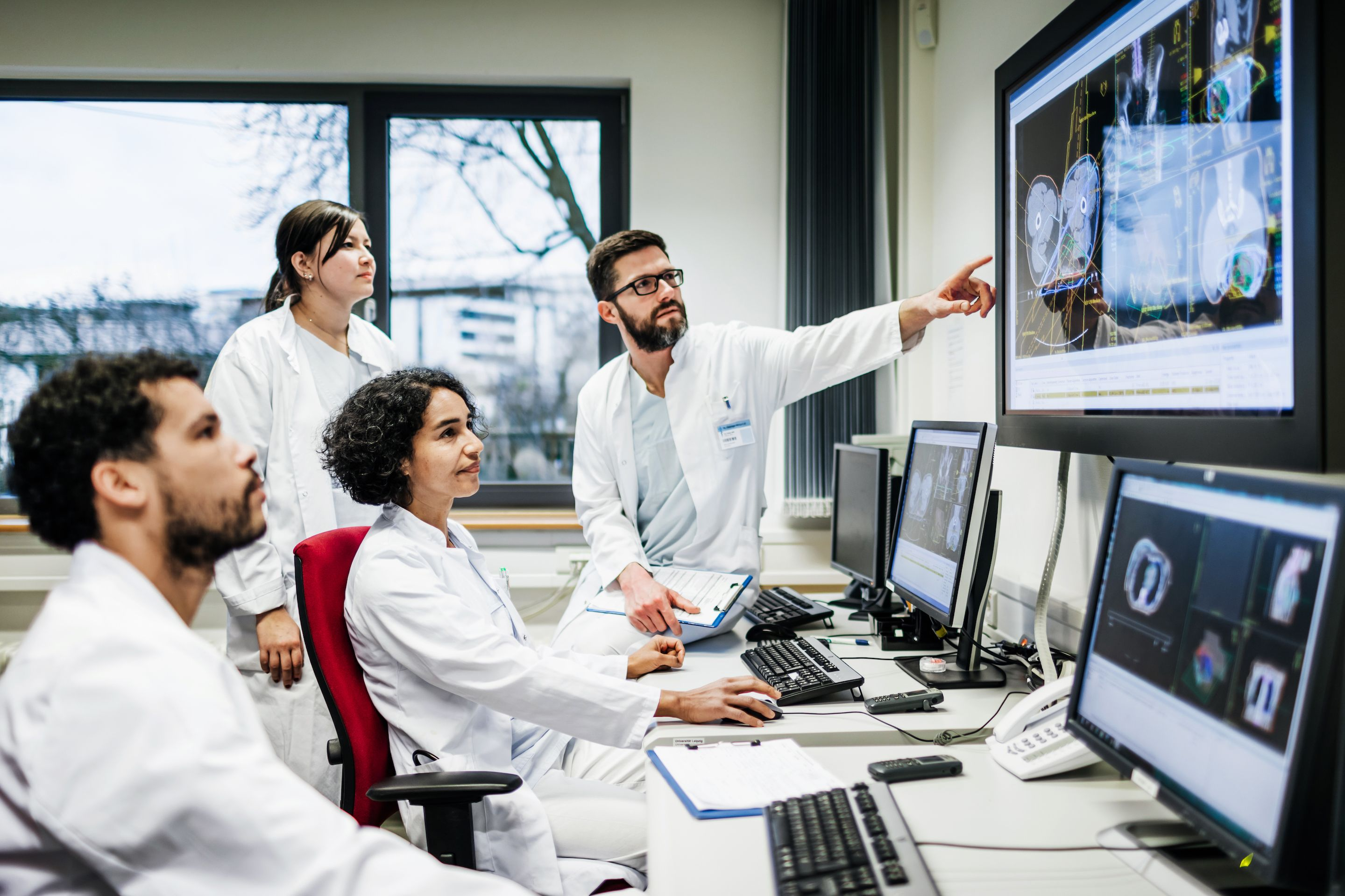 Scientists looking at digital test results