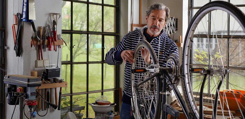 Guy fixing a bike